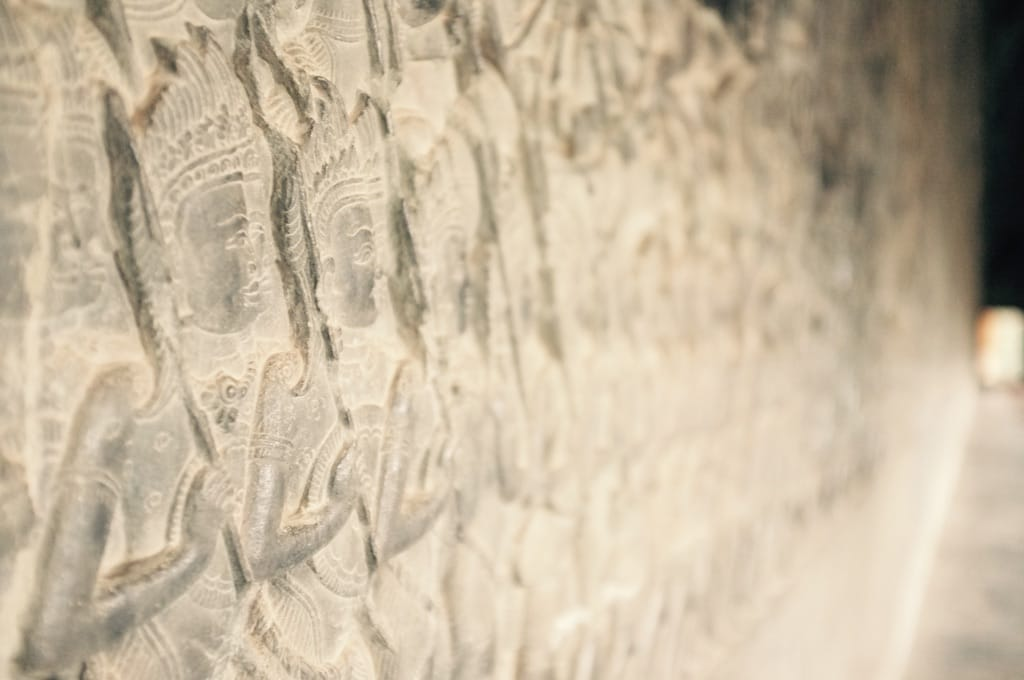 Figures on a stone wall decoration.
