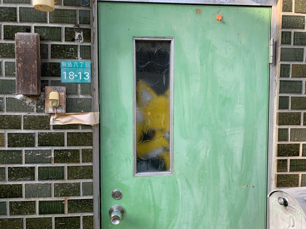 Stuffed animal through the opaque glass of a window.